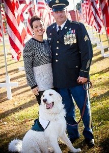 Douglas and Britnee Kinard with service dog Gunner.