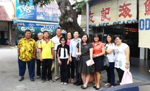 Dr. Zeny Panol (center, wearing black and white) with faculty and students in Malaysia.