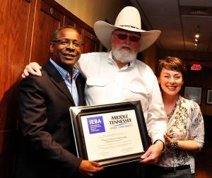 Charlie Daniels (center) poses with MTSU President Sidney McPhee and Pam Matthews, executive director of the International Entertainment Buyers Association. Photo by Vicky Tubb