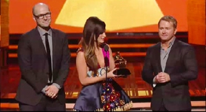 Singer Kacey Musgraves, center, holds the 2014 GRAMMY Award for Best Country Album during the televised event as the album's co-producers, MTSU alumnus Luke Laird, left, and Shane McAnally, look on. (Photo courtesy of GRAMMY.com)