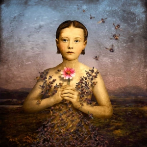 "Digital artist/photographer Maggie Taylor created this photo, ""Girl in a Bee Dress, 2004,"" from an antique photo and other images scanned into her computer and manipulated with Adobe Photoshop software. This photo and some similar works were included in the introduction to the CBS TV series ""GhosT Whisperer."""