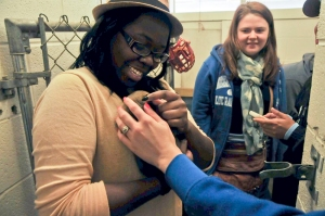 Student Chelsea Johnson pets a greyhound pup while Amanda Gambill looks on. Photo by Ray Wong.