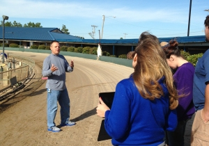 Students on the track learn about racing from Southland Park Director of Racing Shane Bolender. Photo by Cary Greenwood.