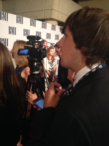 The Music City Project's Zach Ward monitors questions and answers in preparation for live tweeting from the red carpet at the BMI Awards Nov. 4.