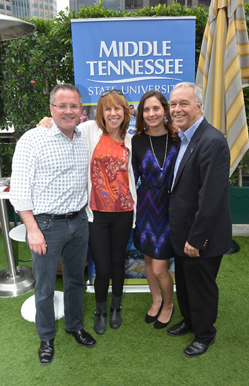 MTSU alum Pete Fisher (left), general manager of the Grand Old Opry, joins Erika Nichols, general manager of Nashville's Bluebird CafŽe (second from left) and Ken Paulson, dean of the College of Mass Communication (right), in congratulating MTSU alumna Alicia Warwick, executive director of The Recording Academy's Nashville chapter. MTSU photo by Andrew Oppmann.