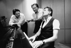 Jerry Lee Lewis playing piano with cousins Mickey Gilley (left) and Jimmy Swaggart. Photo by Chris Harris.