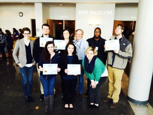 Students hold some of the awards earned at the Southeast Journalism Conference. Front row, from left: Maranda Faris, Dylan Aycock and Laurel O'Neill. Back row, from left: Meagan White, Conner Grott, Samantha Hearn, Leon Alligood (faculty adviser), Greg French and John Connor Coulston.