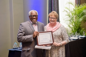 Dwight Brooks, School of Journalism Director, left, and Sharon Fitzgerald, Ed Kimbrell Excellence in Teaching Award recipient.