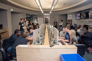 Members of the Innovation J-Camp edit their video projects in the Center for Innovation in Media.