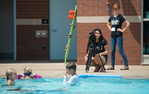 Sophia Chen from MLK Magnet Charter School records B-roll for a video project at the Campus Recreation Center outdoor pool during the Innovation J-Camp in July.
