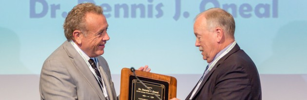 Dr. Dennis Oneal (right) receives the highest honor from the Tennessee Association of Broadcasters.