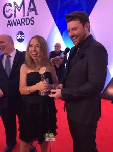 Cindy Watts receives her CMA recognition from country music star Chris Young.