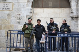 Dr. Sanjay Asthana with Israeli law enforcement at the Damascus Gate in Jerusalem.