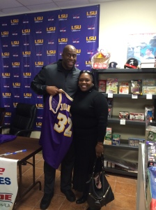 Merida with basketball legend Magic Johnson