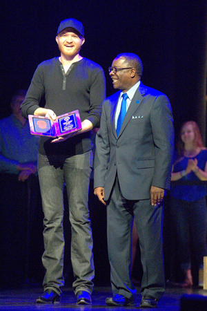 Eric Paslay holds the university's 2015 Young Alumni Achievement Award, presented by MTSU President Sidney A. McPhee. (MTSU photo by J. Intintoli)