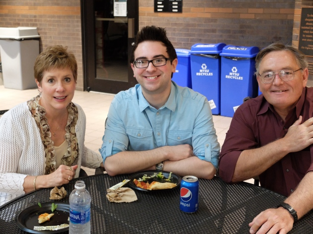 Graduating senior and public relations major Colby Denton and his parents celebrated with friends and faculty at the college's graduation reception in Bragg.
