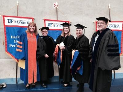 Christine at Ph.D. graduation.jpg